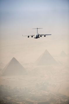 U.S. Air Force C-17 flies over pyramids of Giza Plateau