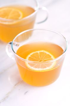 How to make a hot toddy with bourbon, rum or other dark spirit, lemon, honey and hot water. Plus, lots of suggestions for variations. From inspiredtaste.net | @inspiredtaste