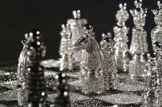 """Royal Diamond Chess Set """"The Royal Diamond Chess"""" entirely hand-made in 14-carat white gold set with approximately 9900 black and white diamonds is an extraordinary luxurious version of the classic chess-set. Designed by the renowned French artist designer and master of jewelry Bernard Maquin and as part of the Charles Hollander Collection """"The Royal Diamond Chess"""" is a rare and precious work of fine art jewelary. This entirely hand-made creation is an expression of meticulous artisanship…"""