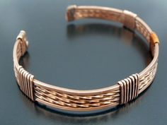 Unisex Twisted and Polished Copper Cuff Bracelet. $37.00, via Etsy.