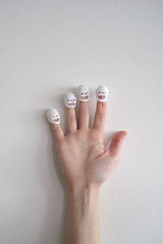 tiny crocheted finger skulls by dewey decimal crafts :)