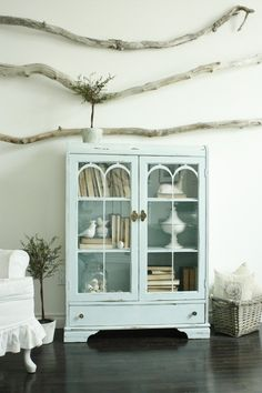 distressed cabinet. I really love those branches...