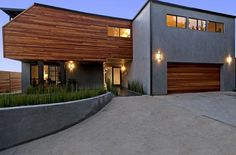Modern Wood Siding House Gray Stucco Wooden Modern Siding Options Combination Modern House Design Front Yard Home Decorations Items And Tools Wood Siding House, Stucco Siding, Stucco Homes, Stucco Exterior, Exterior House Colors, Modern Exterior, Exterior Homes, Siding Colors, Cedar Siding