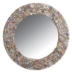 Un beau miroir rond en papier recyclé. Retrouvez le sur notre site internet pour 99,90€. Il a un petit air de maison de vacance.