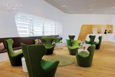 The lounge features Naoto Fukasawa chairs, Nendo tables, and wool rugs.