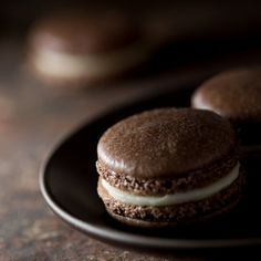 Salted caramel mocha macarons – chocolate espresso-flavored shells filled with a caramel buttercream and coarse salt sprinkles.