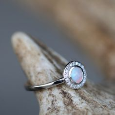 Opal and halo engagement ring handcrafted by Staghead Designs.