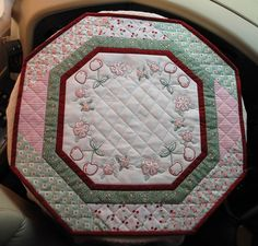 "9-2-15 Cherry themed table topper.  Hand embroidery, machine pieced and quilted.  19"" across."