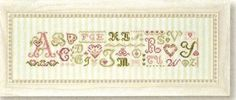 JBW Designs - Alphabet Hearts - Cross Stitch Pattern. Worked on striped fabric from Fabric Flair.