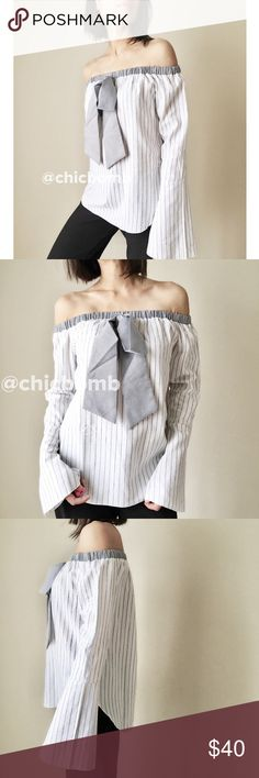 """MANGO off shoulder ribbon tie shirt blouse top Classic shirt reconstructed to modern beautiful  In style off shoulder shirt with ribbon tie by Mango. Top quality 100%cotton . Slight flare bells sleeve. Casual chic.  Size S: bust 34"""",length 20"""" width34"""". Size M :bust 35"""",length 20"""" width 35"""". Size L : bust 36"""", length 21"""", width 36. Available in blu. Follow me on  INSTAGRAM: @chic_bomb  and FACEBOOK: @thechicbomb CHICBOMB BOUTIQUE Tops Tunics"""