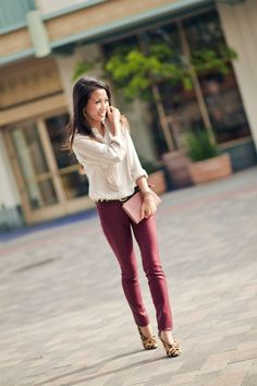 white polka dot top, burgundy pants, leopard pumps