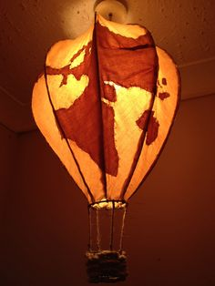 A new huge lampshade world map balloon from J R Kenny. Blindly point your finger on this balloon an sail away to your destination. Created for J R's shop Midnight Wire...