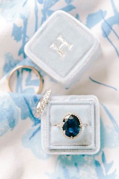 Unique sapphire in a halo setting: Photography : Katie Stoops Photography | Jewelry : Kate Spade | Engagement Ring : Custom By Lauren B Fine Jewelry And Diamonds, New York | Wedding Dress : Enzoani Read More on SMP: http://www.stylemepretty.com/2017/03/14/3-ways-brides-are-influenced-by-celebrity-engagement-rings/