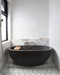 With its perfectly curved form and deep interior, this award-winning NativeStone concrete bathtub provides breathtaking beauty and optimum comfort. Avalon's thick walls provide insulation to ensure that a hot, deep, relaxing soak will last and last. Zen Bathroom, Bathroom Sets, Modern Bathroom, Master Bathroom, Industrial Bathroom, Bathroom Wallpaper, Bathroom Layout, Concrete Bathtub, Stone Bathtub