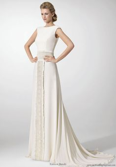 "clean ""less is more"" understated styles and accents. Raimon Bundo structured wedding dress with lace panel sash"