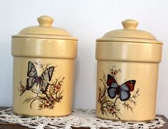 """Round Pottery Staple Canisters with Butterfly Motif, a Vintage Collectible can fly in your kitchen or anywhere in your house. They are the same size: 7-3/4"""" in height up to the lid, 10-1/4"""" in height including the lid; 6"""" in diameter and made in the USA. No chips, crazing or cracks by NookCove, $3.34"""