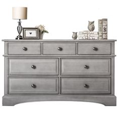 Bring a touch of sophistication to your infant's bedroom decor with this double-drawers dresser. Rope accents, routed detailing, and decorative drawer pulls create an air of elegance, while side-mount