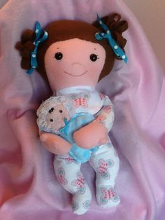 A cute little newborn baby girl with her own babydoll. Our sweet, cuddly 15 inch soft cloth doll is ready to be loved. This unique pattern combines the doll with unremovable PJs so Baby Sister never gets cold. She is cuddling his favorite dolly and is ready for you to read her a bedtime story and snuggle.This Easy Soft 15 inch Cloth Doll PDF Pattern includes pattern for doll with permanent clothes, and stuffed toy.  **This is a pattern ONLY and not a completed doll**  Very fast and easy to…