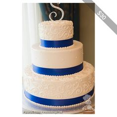 White Buttercream Icing, Hand Piped Scrolls Swiss Dots, Royal Blue Ribbon
