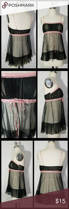 """Victoria's Secret Black Baby Doll Dress Lingerie Made of a sheer black polyester fabric trimmed with pastel pink. Low scoop neck with tiny accordion pleat bust and Empire waist. Pink ribbon running through Empire waist for perfect fit. Straps are adjustable. Labeled size XS. MEASUREMENTS:(taken while laying flat so double for bust and waist) Bust:15.5"""" Empire Waist:up to 15.5"""" Hips: free Length:(not including straps)21"""" In excellent condition. Never worn. Victoria's Secret Intimates…"""