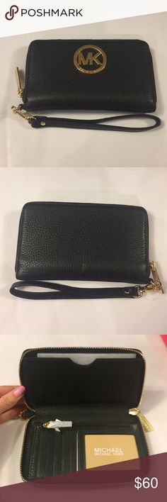 Michael Kors wallet! MK wallet..purchase tag removed but never used! Removable strap Michael Kors Bags Wallets