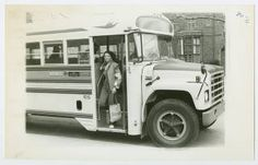 Student getting off Five College Bus, with South Rockefeller Hall in the background :: Archives & Special Collections Digital Images :: circa 1970-1979