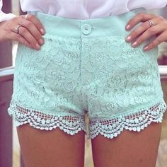 Mint Green Shorts with white Lace fringe. Faster at drawing attention than a thong. More powerful a statement than a tattoo. Able to leap out of stereotypes with a momentary glimpse. Look, over there, its puffy deformed lips, its raccoon clan eye make-up, no, wow, its a woman embracing her femininity!