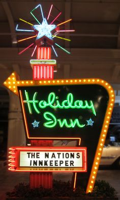 """My family made several road trips from Tennessee to California during my childhood. My first traveling memory is on one of these trips when I was 3 years old.  I called Holiday Inns """" California's"""" because we always stayed in one each night on our way to California so I recognized the sign!  Holiday Inn neon sign circa 1960's"""