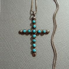 A Beautiful Vintage Native American Turquoise Cross Necklace Pendant, Handmade in Sterling Silver featuring Eleven Petit Point Snake Eye Genuine Turquoise Gemstones in a Rich Blue Color on 18 Vintage Sterling Hallmarked ITALY Chain, Weight 3.9 Grams circa 1960s!  Measurements for the Cross are 1-3/8 in length by 1 in width. Chain is 18 in length. This Early Native American Cross has Striking Bright Blue Turquoise Gemstones. Everything is in Excellent Condition with no chips or cracks to ...