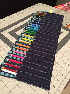 Colored pencil roll from upcycled thrift store fabric.  Made using mypoppet tutorial as a guide.