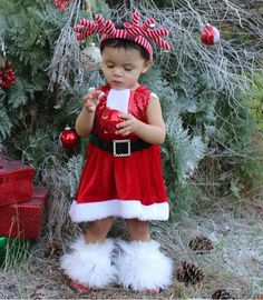 Miss Dalary looks like a holiday princess in her gorgeous velvet Santa dress!  Now in stock and ready to ship! Size 12M and up $39.99