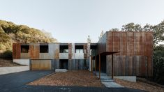 A rusted steel building juts from the San Franciscan earth; an ecological structure shaded by a collection of ancient oaks. This home was designed for a family of four by Californian studio, Faulkner Architects.