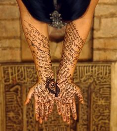 Delhi in the monsoon is a muse for poetry and metaphor for romance:   As an ode to the long-awaited first monsoon rain, we used henna to write traditional Malhar, Kajri and Sawan song lyrics in fluid devanagari calligraphy.    Photographed at Bara Gumbad, Lodi Gardens. Graciously modeled by designer, Shubhangini Singh.