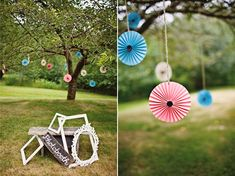 Photo booth and pinwheels hanging in tree
