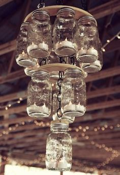 Country Girl Chandelier~ I don't think I would actually do this< But do I ever put everything in mason jars!!