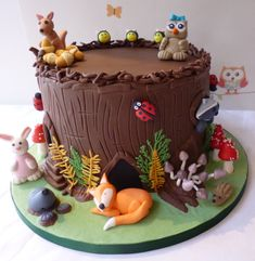This is the woodland creatures cake I made for my daughters birthday recently. The cake comprises 6 layers of belgian chocolate mud cake with chocolate ganache and chocopan dark chocolate sugarpaste. I hope you enjoy looking at it as much as I. Chocolate Mud Cake, Belgian Chocolate, Chocolate Ganache, Carolines Cakes, Nature Cake, Animal Birthday Cakes, Fox Cake, Cupcake Cakes, Cupcakes