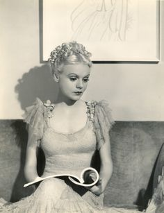 """Marie Wilson reading, 1930s. Photograph by Scotty Welbourne. After making her Warner's debut in Broadway Hostess (1935), Wilson adroitly moved around and about the """"B""""-level chain (along with an intermittent """"A"""" movie). As the quintessential dizzy,..."""