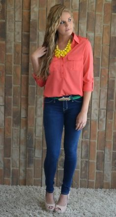 Loose peach shirt with denim jeans and neutral heels.