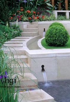 Harpur Garden Images :: chel0441z Contemporary style water feature with steps, rill and retaining wall. border bed beds flowerbeds flowerbed buxus sphere ball box bench seat seats green foliage modern RHS Chelsea 2004. Design: Leeds City Council. From Freedom to Future Small water features Steps Contemporary Borders Jerry Harpur Please read our licence terms. All digital images must be destroyed unless otherwise agreed in writing. Photograph by: www.harpurgardenlibrary.com Contact: Harpur…