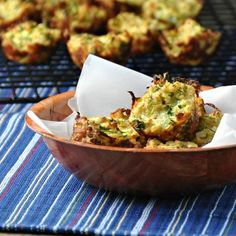 """""""I'm always looking for great, healthy snacks for our family. This is a great way to get the kiddos to eat their vegetables! I used slightly less onion in our muffins since they were geared to a 2-year-old. These are very similar to a potato pancake, except you are using zucchini instead of potato,"""" Maeghan of The Way to His Heart says of her Summer Zucchini Bites."""