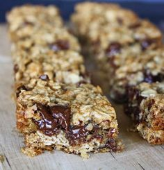 Banana Oatmeal Breakfast Bars - Soft and chewy oatmeal bars with a great hit of banana flavor, speckled with chocolate chips, baked and served warm. Don't let the oatmeal fool you, these are breakfast, lunch, dinner and dessert, if you ask me!