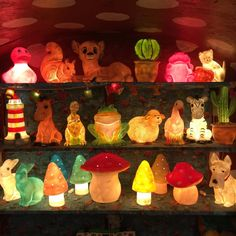 Akotee boutique, Antwerp, Belgium. Store display, kids shopping. Red and white polka dot round ceiling. #lampjes#kinderlampjes#akotee #cactus #bambi #paddestoel #konijn #zebra #pink #vuurtoren #kikker #nachtlampje #beestenboel #allemaallichtjes