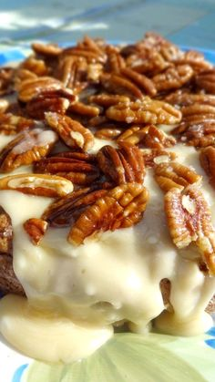 Apple Cake with Butter Cream Icing & Toasted Pecans Recipe ~ Fresh apples are baked into this moist and delicious spiced cake, then draped with a butter cream icing and topped with warm toasted pecans, for a simply sensational dessert