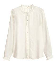 15 Long-sleeved blouse in woven fabric with pearlescent buttons and lace trim inserts at front and ruffle trim at neckline and cuffs.