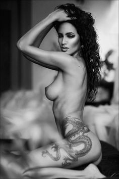beautiful full bodied dragon tattoo. a very nice black and white picture too!
