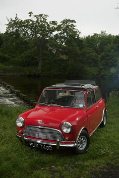 Orignal Mini Cooper S..Very Nice....In my good old days..... Loved my HBX11N Mini 1000cc twin carb, red with black roof, nudge bars, paddy H seats, minilites and 4 branch manifold to straight thru box....good days.back in the day !!