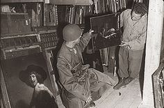 Citation: Soldiers with Jan Vermeer's The Astronomer, 1945 / unidentified photographer. Salt Mines and Castles : lecture, by Lamont Moore, A...