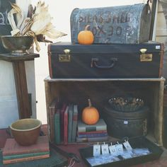 Vintage suitcase + books.