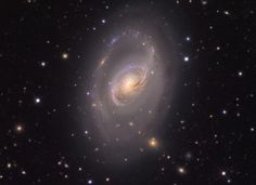 Dust lanes seem to swirl around the core of Messier 96 in this colorful, detailed portrait of the beautiful island universe. Of course M96 is a spiral galaxy, and counting the faint arms extending beyond the brighter central region it spans 100 thousand light-years or so, about the size of our own Milky Way.