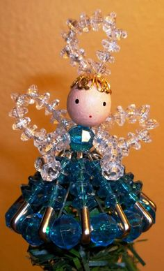 Angels made from crystal beads.